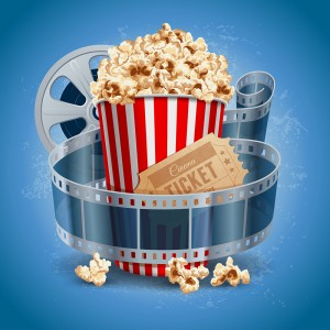 Popcorn with movie ticket wrapped in film