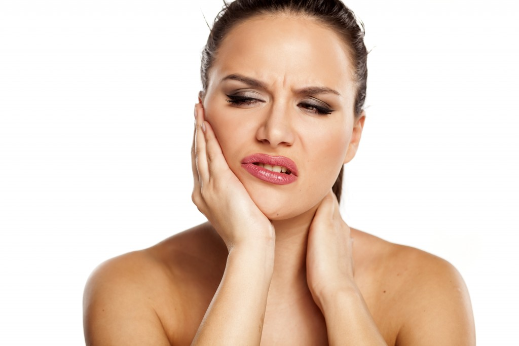 Woman with TMJ Jaw Pain